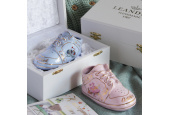 Small shoe on the occasion of child´s birth in gift packaging white
